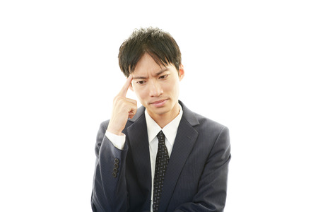 Businessman having a headache photo