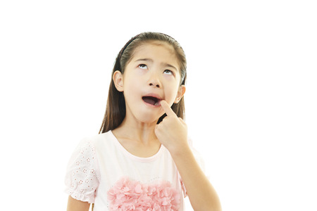 Girl complaining of toothache photo
