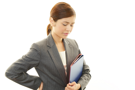 Business woman with low back pain photo