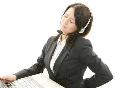 Tired and stressed call center operator photo