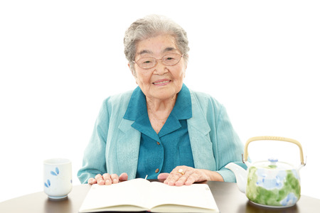 Old woman reading her book  photo