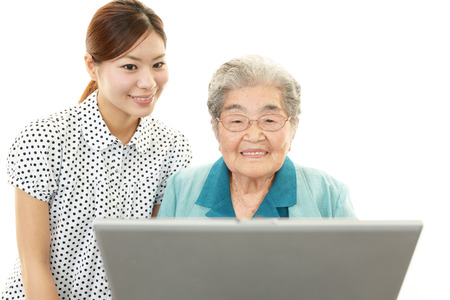 nursing class: Old woman enjoys computer