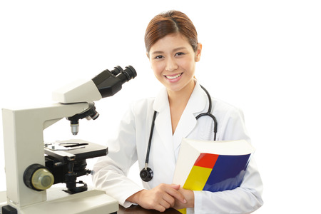 Doctor with a microscopic examination photo