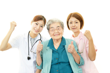 Senior woman with medical staff photo