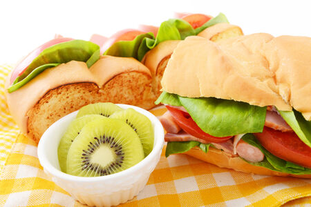 Breakfast with fresh kiwi fruit and tasty sandwich photo