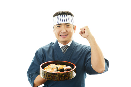 Portrait of a sushi chef photo