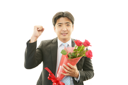 Man holding flower bouquet photo