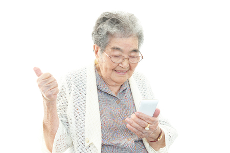 Old woman with smart phone