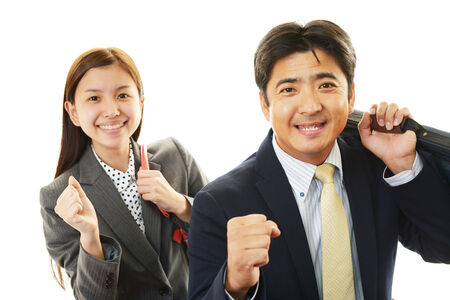 Smiling businessman and businesswomen photo