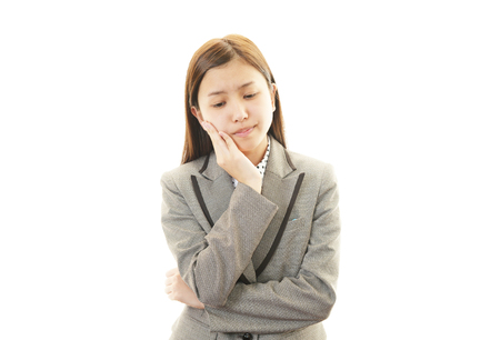 Tired and stressed young Asian woman Stock Photo