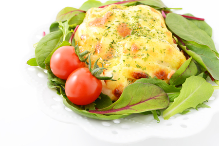 Tasty chicken gratin with salad photo