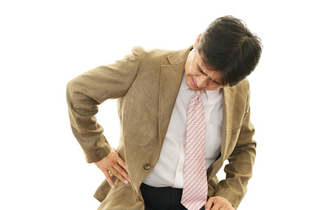Businessman having back pain  photo