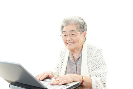 Old woman enjoys computer photo