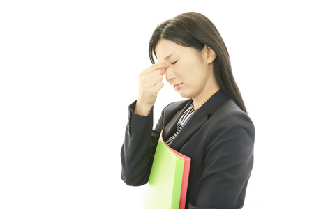 Tired and stressed young Asian woman photo