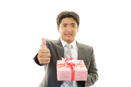Smiling businessman with present photo
