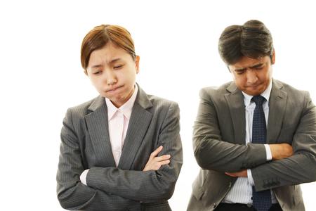 Dissatisfied businessman and businesswomen  photo