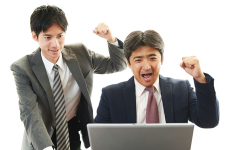 The male office workers who poses happily  photo