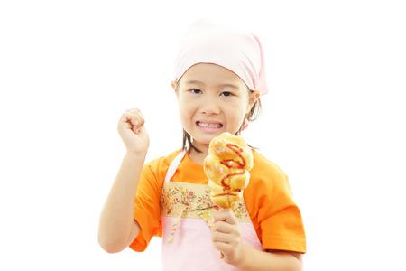 Little girl eating food 版權商用圖片