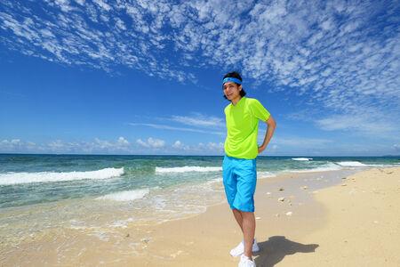 Young man on beach 版權商用圖片