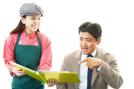 Waitress shows the menu to customer photo