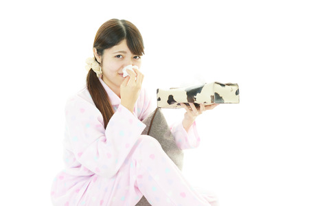 Woman having cold photo