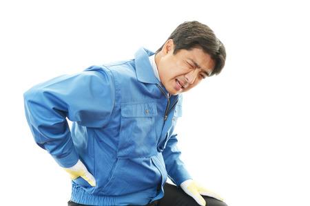 Asian worker having back pain.