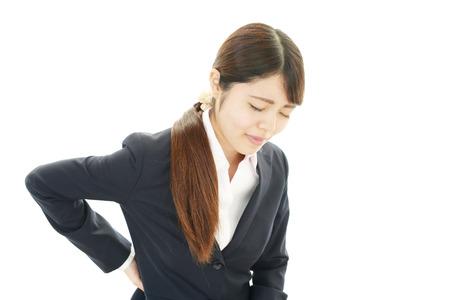 Woman back pain photo