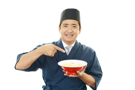 Asian chef with noodle photo