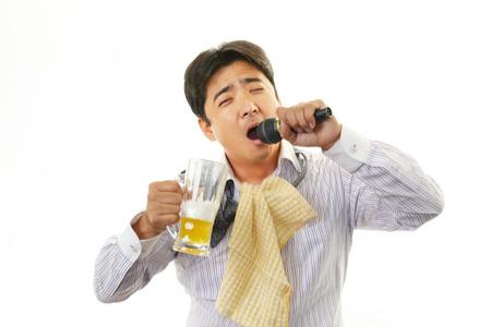 karaoke bar: Drunk businessman man with beer