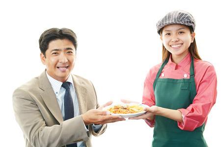 Waitress serving customer photo