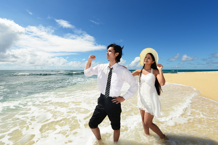 Man and woman on the beach photo