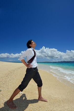 Businessman on the beach photo