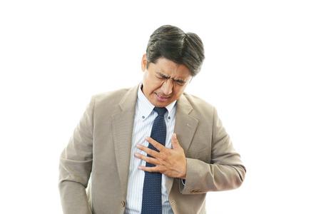heart problems: Tired businessman