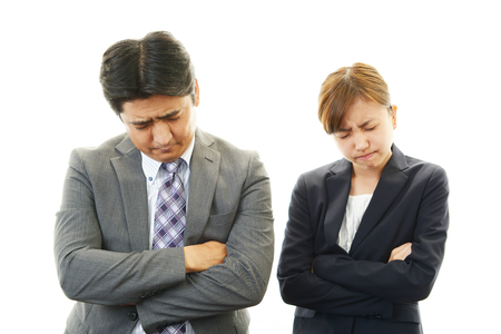 dissatisfied: Dissatisfied businessman and business woman  Stock Photo