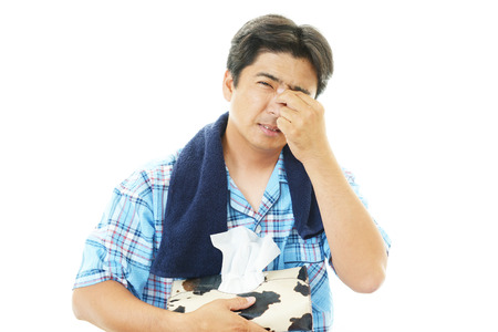 Man having a cold Stock Photo - 28393518