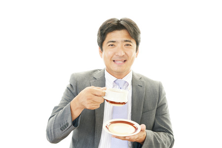 Man having a coffee break photo