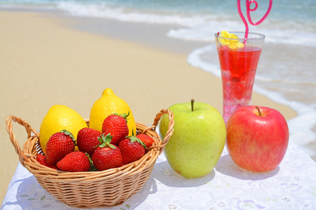 Fresh fruits on the beach photo