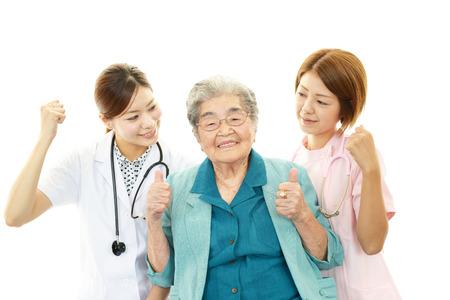 Senior woman with medical staff