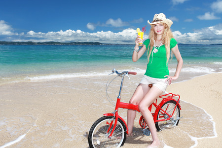 Woman riding a bike on the beach photo