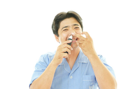 salaried worker: Man taking care of his nose hair Stock Photo