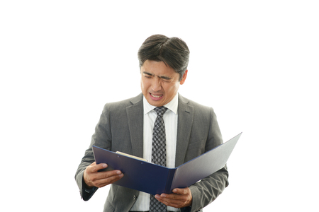 pay cuts: Disappointed Asian businessman