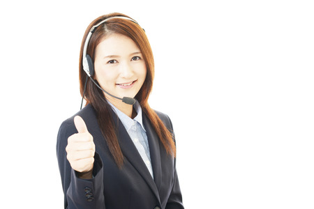 Call center operator showing thumbs up sign photo
