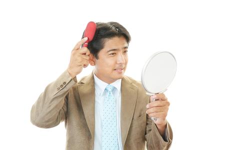 Man combing his hair photo