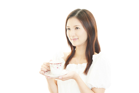 Portrait of young woman drinking coffee. photo