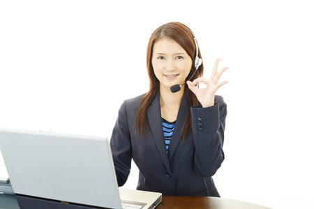 Call center operator making ok sign photo