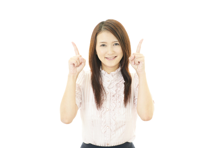 Young business woman pointing upward photo