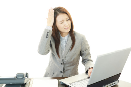 Stressed young business woman photo
