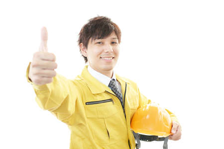 Asian worker with thumbs up photo