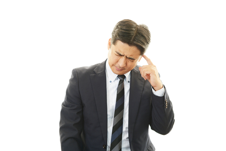 Disappointed Asian businessman photo