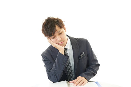 Tired Asian businessman photo